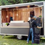 Man opening food truck for business, Innsbruck Tirol, Austria